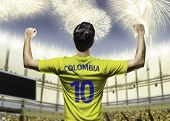 Colombian soccer player celebrates on the stadium