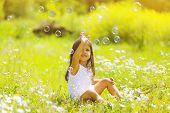 image of have sweet dreams  - Child having fun in summer day soap bubbles - JPG