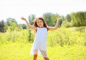 stock photo of have sweet dreams  - Happy little girl having fun in summer day - JPG