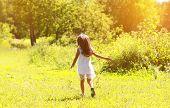 Little Girl Walks On Nature