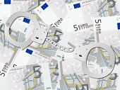 Handcuffs On Five Euro Background