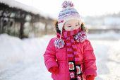 Little Girl Walking In Purple Wintercoat