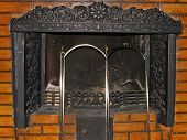picture of metal grate  - Metal fireplace with an iron grate in masonry - JPG