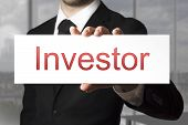 Businessman Holding Sign Investor