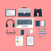 Workplace with laptop on pink background