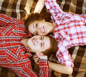 Young Cool Happy  Together Having Fun In Love, Boyfriend And Girl Lying On The Plaid Looking Up, Top