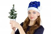 Image of woman with small christmas tree