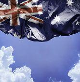 Australia waving flag on a beautiful day