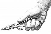 stock photo of stippling  - Pen and ink illustration of a doctors hand holding a tool - JPG