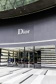 SINGAPORE - CIRCA MAY 2014: Dior store. Dior, it's one of world's top fashion brands which includes women's clothing, menswear, jewelry and perfume.