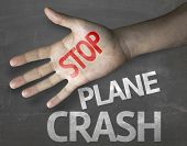 Educational and Creative composition with the message Stop Plane Crash on the blackboard