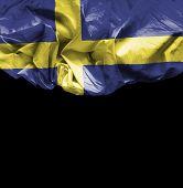 Sweden waving flag on black background