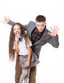stock photo of tease  - Teasing friends boy and girl brother and sister having fan isolated on white studio portrait - JPG
