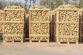 picture of cleaving  - Solid biofuel as fire wood made of birch stacked on pallets in outdoor stock - JPG