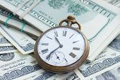 stock photo of american money  - money and time concept  - JPG