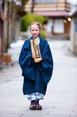 pic of japan girl  - Little girl wearing yukata traditional Japanese kimono at street of a onsen resort town in Japan - JPG