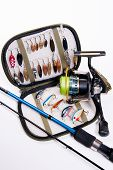 stock photo of fishing rod  - Fishing rod and lures with bag for baits on white - JPG