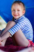 foto of cabana  - Little girl at luxury resort relaxing at beach cabana - JPG