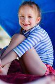 foto of cabana  - Little girl at luxury resort relaxing at beach cabana - JPG