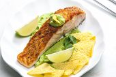 foto of nachos  - grilled salmon fillet with avocado sauce and nachos - JPG