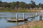 image of pier a lake  - a boat pier leading from bank to water in lake - JPG