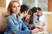 stock photo of students classroom  - Group of students sitting in classroom - JPG
