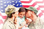pic of reunited  - Soldiers reunited with daughter against rippled us flag - JPG