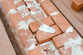 pic of mason  - Mason bricklaying background with trowel clay brick blocks - JPG