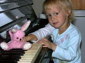 Playing The Piano With A Toy