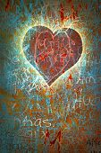 Colorful grunge background with graffiti, writings, a heart and a slight vignette.