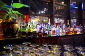 foto of liquor bottle  - Assorted colorful bottles of alcoholic drinks in a night - JPG