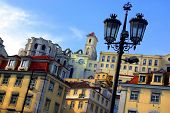 Panorama of the old Lisbon with its typical houses and street lamps