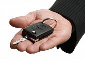 Car salesman or rental man giving a car key to someone