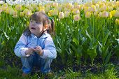 Thoughtful Girl In Tulips