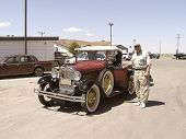 Senior beside a Vintage 1928  Car