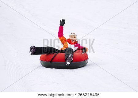 Child Girl On Snow Tubes