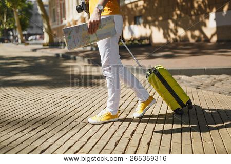 poster of Cropped Image Of Traveler Tourist Woman In Yellow Casual Clothes With Suitcase City Map Walking In C