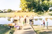 Filtered Tone Blurry Background Family Fishing Community Event Near Lakeside Dock poster