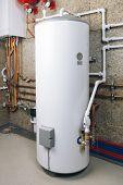 water heater in modern boiler room poster