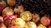Pomegranate And Chestnuts At A Street Market, One Of The Fruits Is Opened Up To Reveal The Pomegrana poster