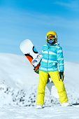 Ski Resort. Vertical Full Length Portrait Of A Girl Snowboard Rider Enjoying A Beautiful Sunny Day I poster