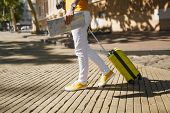 Cropped Image Of Traveler Tourist Woman In Yellow Casual Clothes With Suitcase City Map Walking In C poster