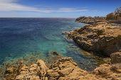 Summertime: Mykonos Island, Greece. Beautiful Scenery Of Rocky Coast: Azure Waters Of The Aegean Sea poster