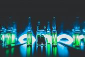 Concept Of Doping In Sport. Bright Ampoules With Luminous Green Contents: Diuretics, Peptide Hormone poster