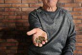 Poor Elderly Man Begging For Money Near Brick Wall, Focus On Hand poster