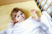 Cute Little Baby Girl Lying In Cot Before Sleeping. Happy Calm Child In Bed. Going Sleep. Peaceful A poster