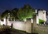 stock photo of beefeater  - The Tower of London illuminated at night - JPG