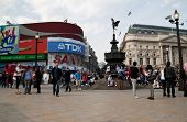 LONDON - MAY 21:Tourists and londoners gather around the statue of Eros at Picadilly Circus May 21,