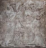 stock photo of sumerian  - Ancient relief of assyrian gods - JPG