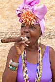 HAVANA-MARCH 28:Woman with typical clothes and a huge cuban cigar on March 28,2011 in Havana.People
